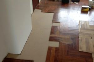 bijleggen / schuren bestaande kambala vloer